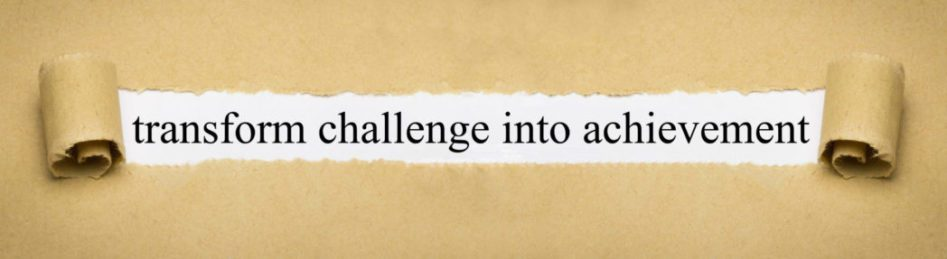 Parchment paper with the phrase, transform challenge into achievement