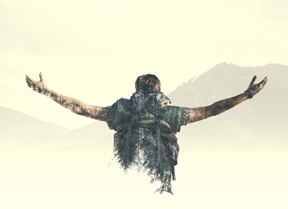 Book cover man with back to us arms in the air looking at the mountains